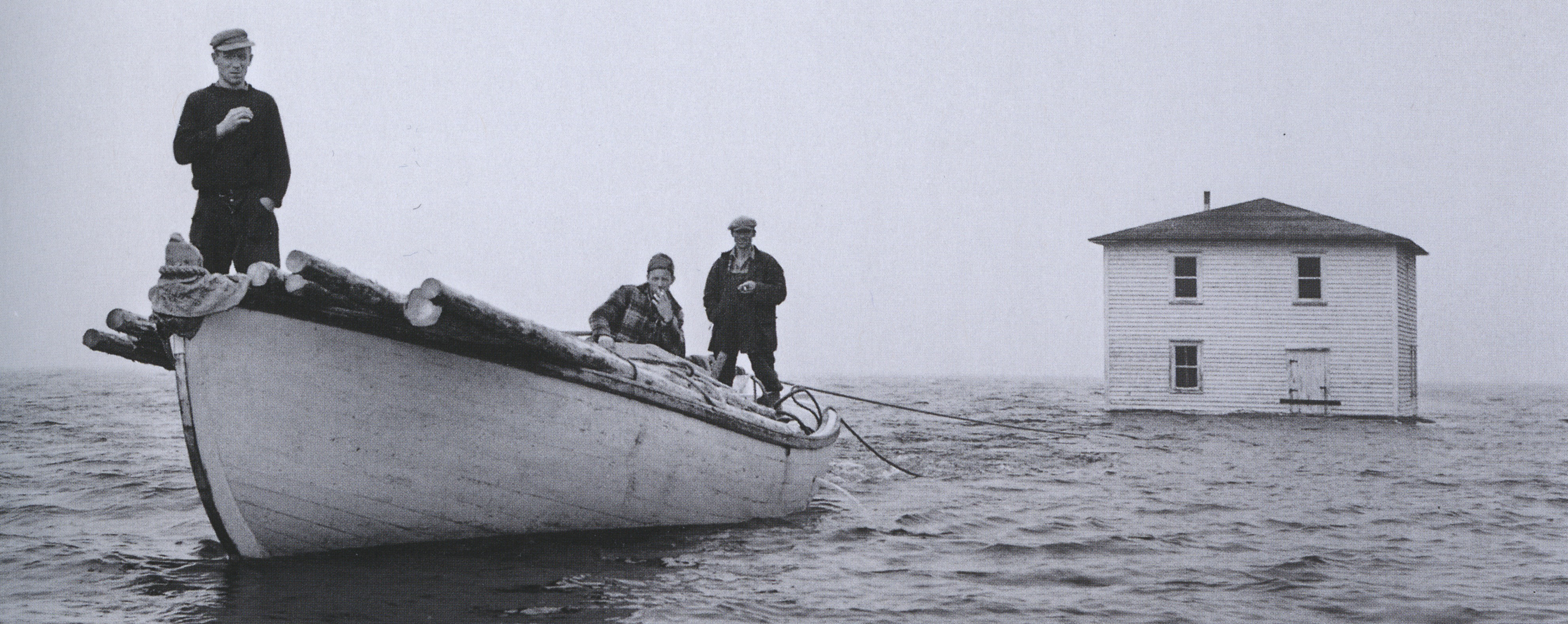 House of M. Rogers being towed to Flat Island, Nwfld_1961